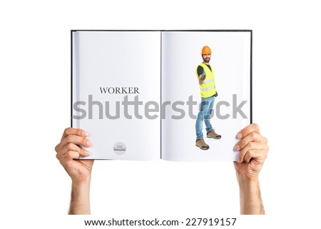Workman with thumb up printed on book - stock photo