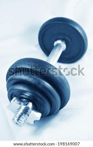 Workout concept with spin-lock collar dumbbell  - stock photo