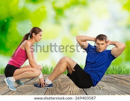 Workout. One caucasian couple man woman personal trainer coach exercising abdominal silhouette studio isolated on white background - stock photo