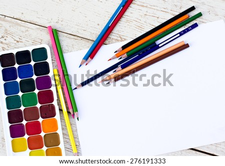 Workplace artist - paper, paint, brushes, color wheel - stock photo