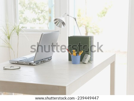 Workplace at home with laptop - stock photo