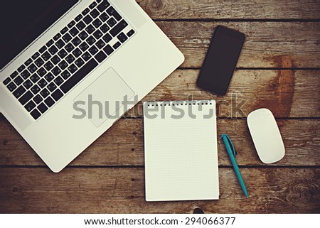 Workplace business still life. blank empty notebook, laptop, tablet pc, mobile phone, pen - stock photo