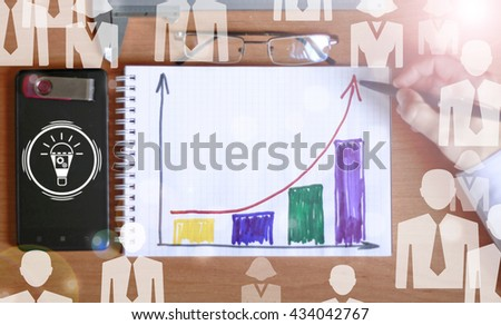 Workplace businessman. Charts, securities, charts on your desktop, notebook, smartphone - stock photo
