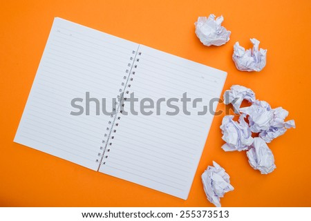 Workplace. Empty notepad with other various office supplies - stock photo