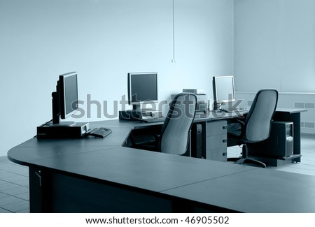 workplace monitor room table chairs - stock photo