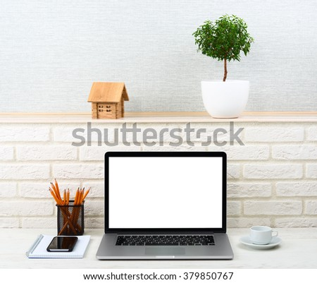 Workplace  of businessman with modern accessories. Laptop on a table with blank screen - stock photo