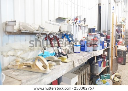 Workplace of car painter. Old spray guns.  - stock photo