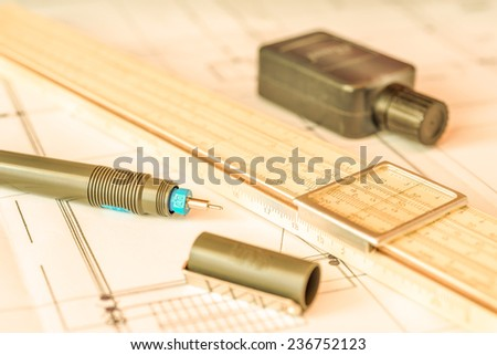 Workplace of engineer, tools for sketching and a drawings. Angle view, in yellow tone - stock photo