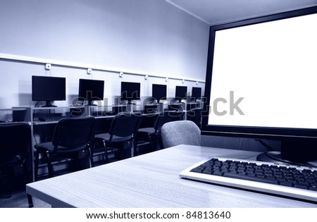 Workplace room with computers in row. - stock photo