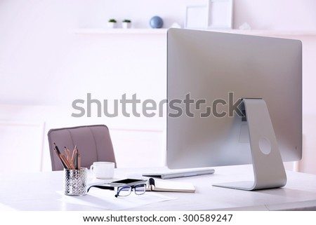 Workplace with computer in room - stock photo