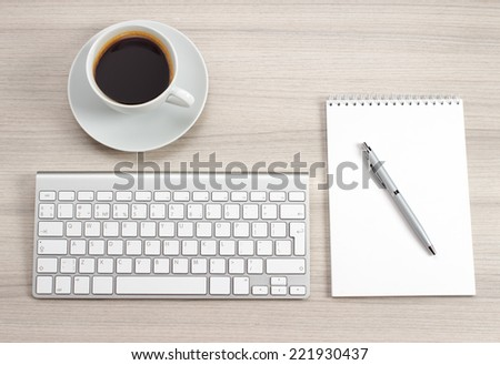 Workplace with notepad, coffee and keyboard - stock photo