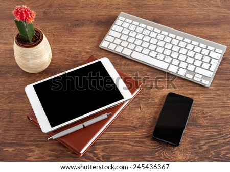 Workplace with tablet and keyboard, and cactus gymnocalycium - stock photo