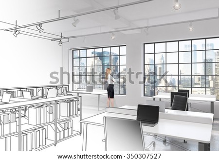 Workplaces in a bright modern loft open space office. Modern computers on tables and book shelves partly drawn. Woman looking through the window. New York panoramic view. Concept of high quality job. - stock photo