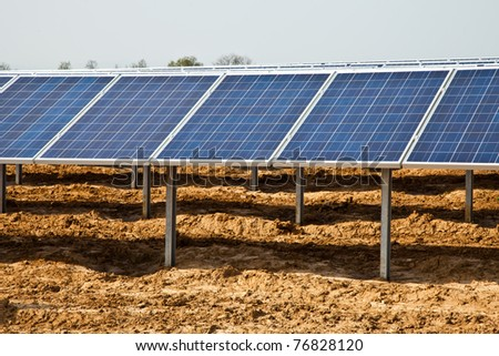 Works in progress in a solar panel plant, - stock photo