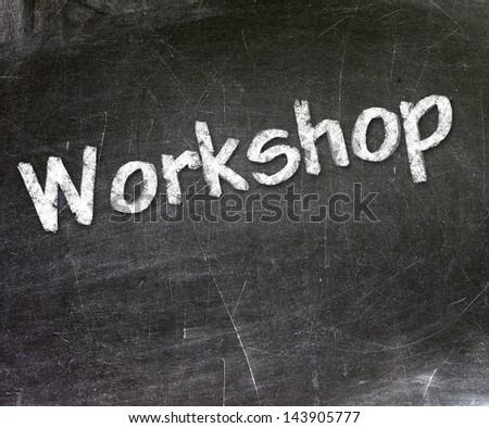 Workshop handwritten with white chalk on a blackboard - stock photo