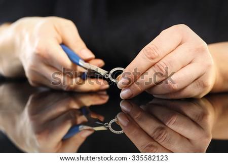 Workshop jewelery, silver jewelery. Jeweler, goldsmith while working on silver jewelry - stock photo