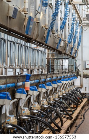 Workshop of dairy farm with equpment for milking cows - stock photo