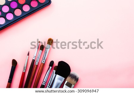 Workspace for makeup with cosmetics on pink background. Top view - stock photo