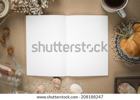 Workspace - Notebook paper with coffee and cookie on table. Background with free text space. - stock photo