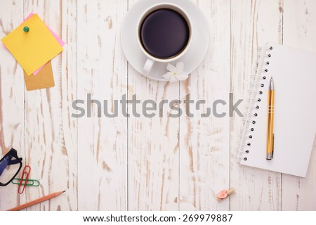 Workspace  Open Notepad.and cup of coffee with post-it note on white wooden background, with copy space on center area.(Vintage warm tone) - stock photo