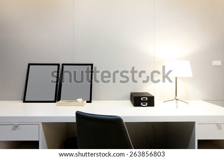 Workspace with desk lamp and picture frame on home or studio - stock photo