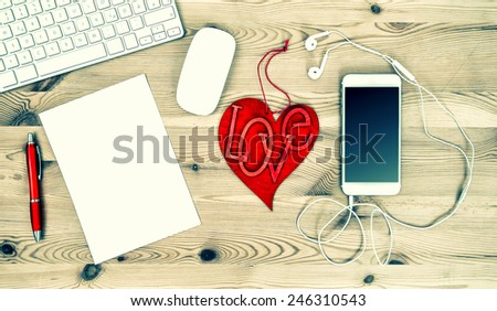 Workstation with Red Valentine Heart, Stationary and Office Supplies. Vintage style toned picture - stock photo