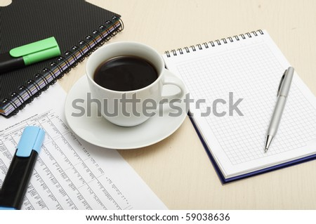 Worktable covered with documents - stock photo