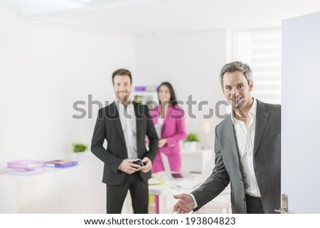 workteam at office welcoming partner - stock photo
