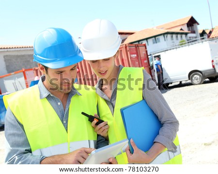 Workteam meeting on building site - stock photo