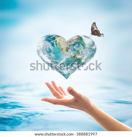 World blue ocean water heart love shape & living freedom butterfly on women human hand on blur wavy rippled day aqua background design logo concept: Saving aqua csr environmental protection campaign - stock photo