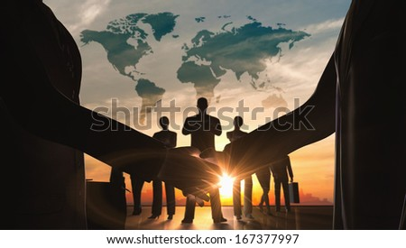 World business shake hand with teamwork silhouettes rendered with computer graphic 3d - stock photo