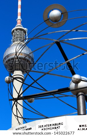 World clock and television tower at Alexanderplatz in Berlin in Detail - stock photo