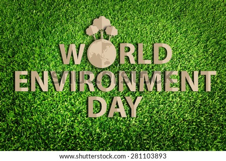 World environment day concept. Paper cut of eco on green grass. - stock photo