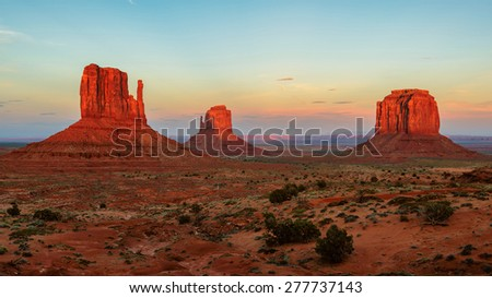 World famous Monument Valley mesas with a colorful sunset  - stock photo
