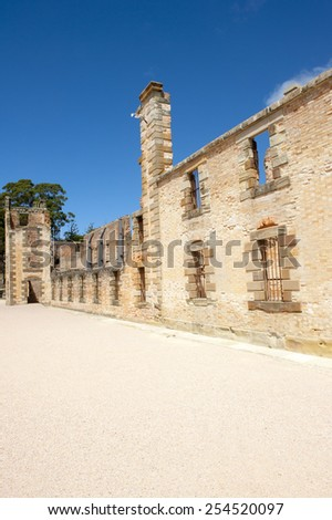 World Heritage Site of  Port Arthur Convict Museum Settlement in Tasmania, Australia, with ruin of historic prison building, tourist attraction, blue sky. - stock photo