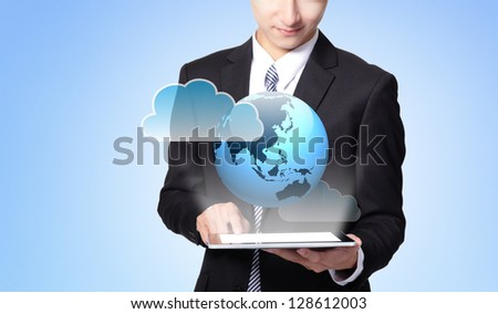 world in your hand - handsome business man using touch screen tablet pc, concept for business and cloud computing, asian man model - stock photo