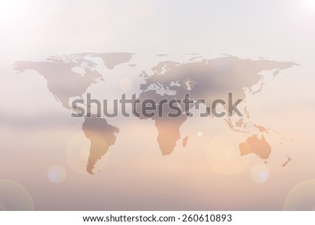 World map atlas on blur sunset/sunrise sky background:abstract blur skyline with flare light wallpaper.sea/water/land/town/city around the global. - stock photo