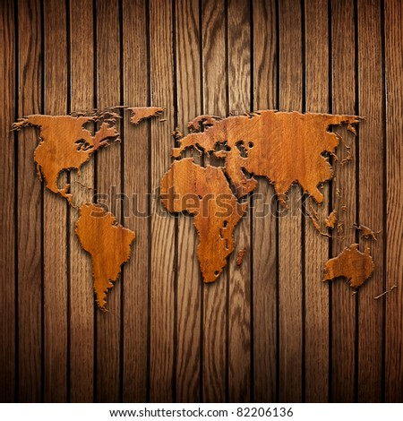 world map carving on wood plank - stock photo