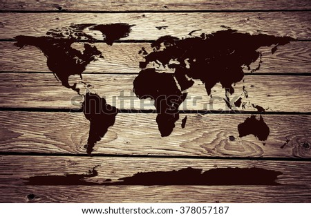 World Map embossed on Grunge wooden deck - stock photo