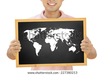 World map on blackboard held by smiling man - stock photo