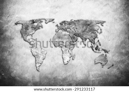 world map on concrete wall background - stock photo