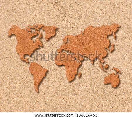 World map on sand background - stock photo