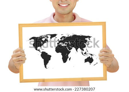 World map on whiteboard held by smiling man - stock photo