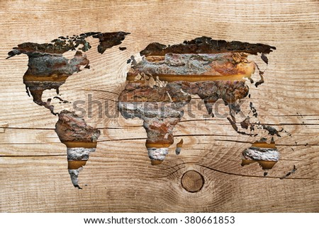 world map on wooden background vintage - stock photo
