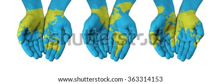 World map painted on hands isolated on white - stock photo