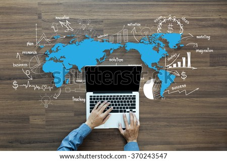 World map with creative thinking drawing charts and graphs business success strategy plan ideas,  With Man hand working on laptop computer keyboard with blank screen monitor, Top View - stock photo