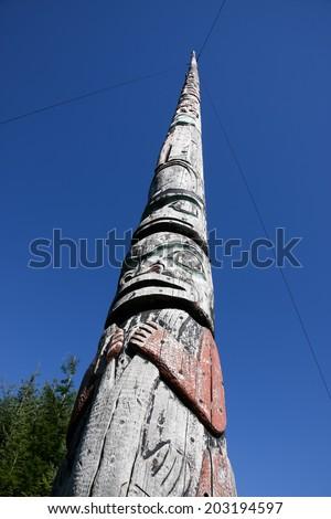 World's Tallest Totem Pole/Tallest totem pole carved from a single tree.  Found in village of Kake, Alaska - stock photo
