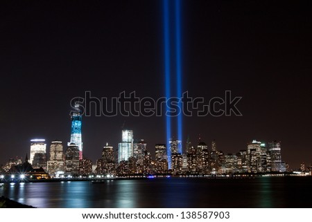 World Trade Center featuring Freedom Tower with Anniversary Tribute Lights from across the Hudson River. - stock photo