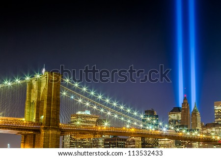 World Trade Center Lights over Brooklyn Bridge in Manhattan New York City at night in HDR - stock photo