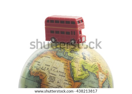 world travel on globe with red bus concept  - stock photo